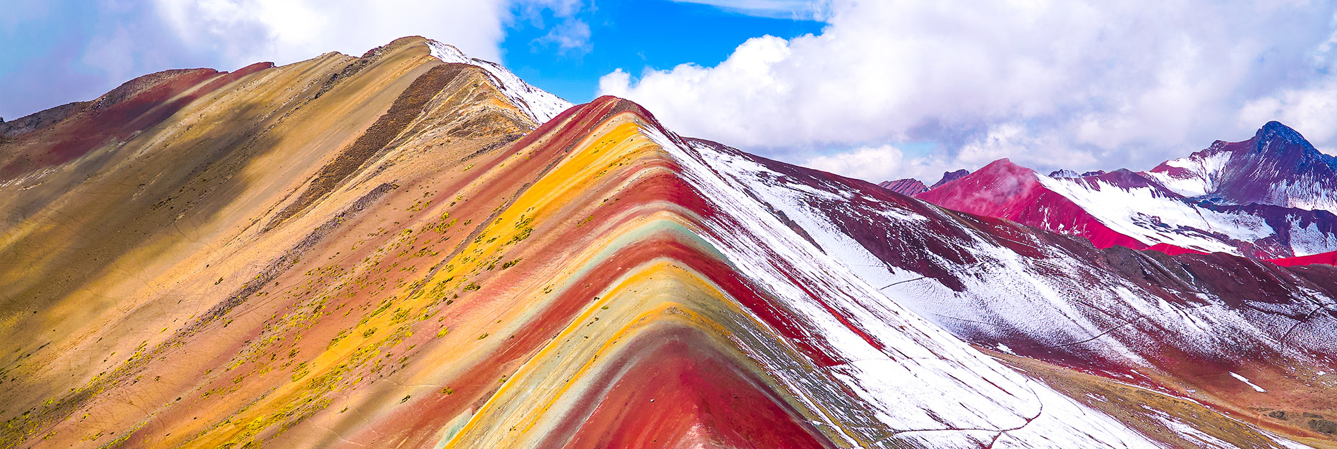 breath taking view of rainbow mountain covered in snow