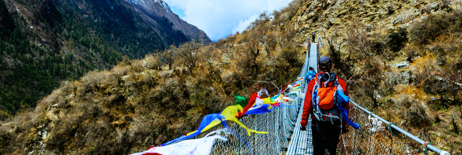 crossing a suspension bridge during the trek