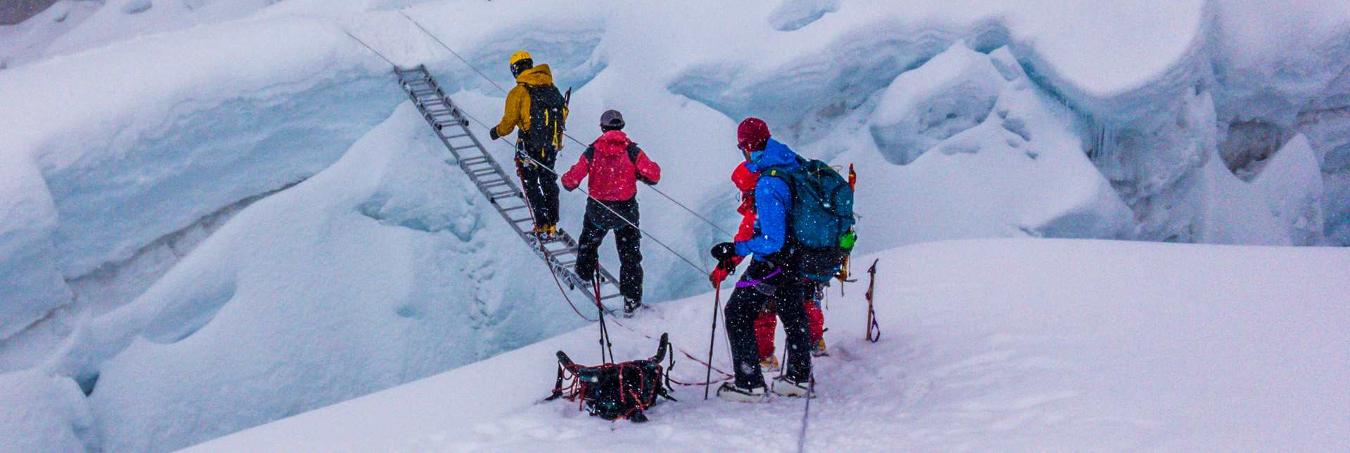 crossing a crevasse during Island Peak climb