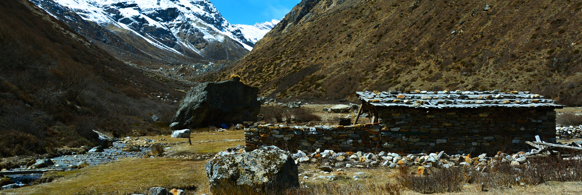 Stone roofed huts during the trek